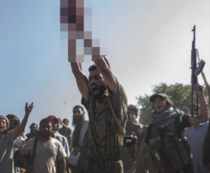 Aftermath of the beheading of an Assad regime soldier by ISIS in August 2013.