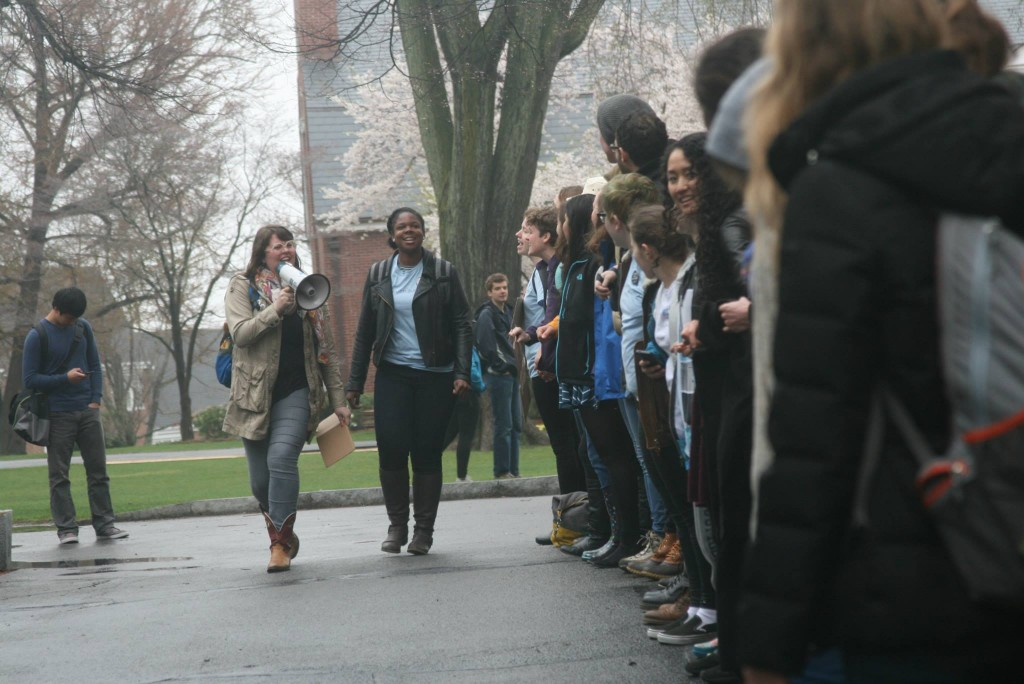 VOX members participate in a May 2014 rally encouraging Tufts to revise its sexual assault policy in May 2014. (Photo by Briana Moody)