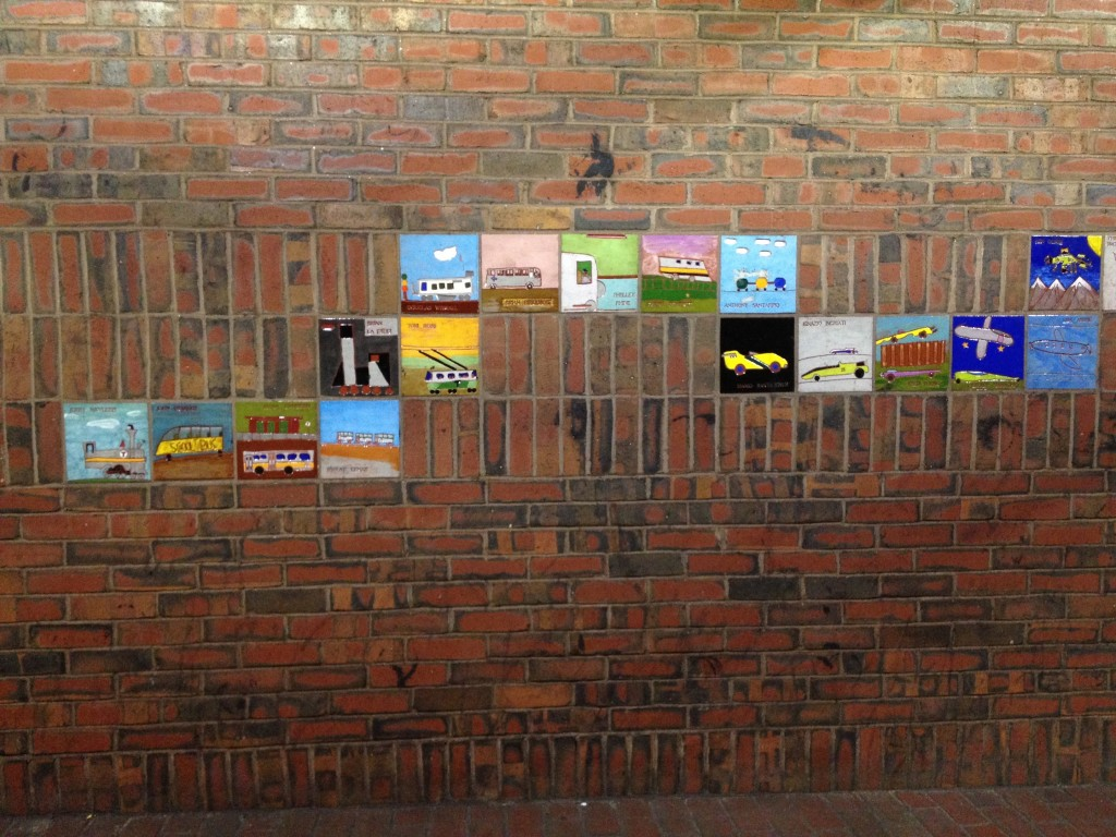 The tiles are nestled between bricks in the Davis T station. (photo by Alison Graham)