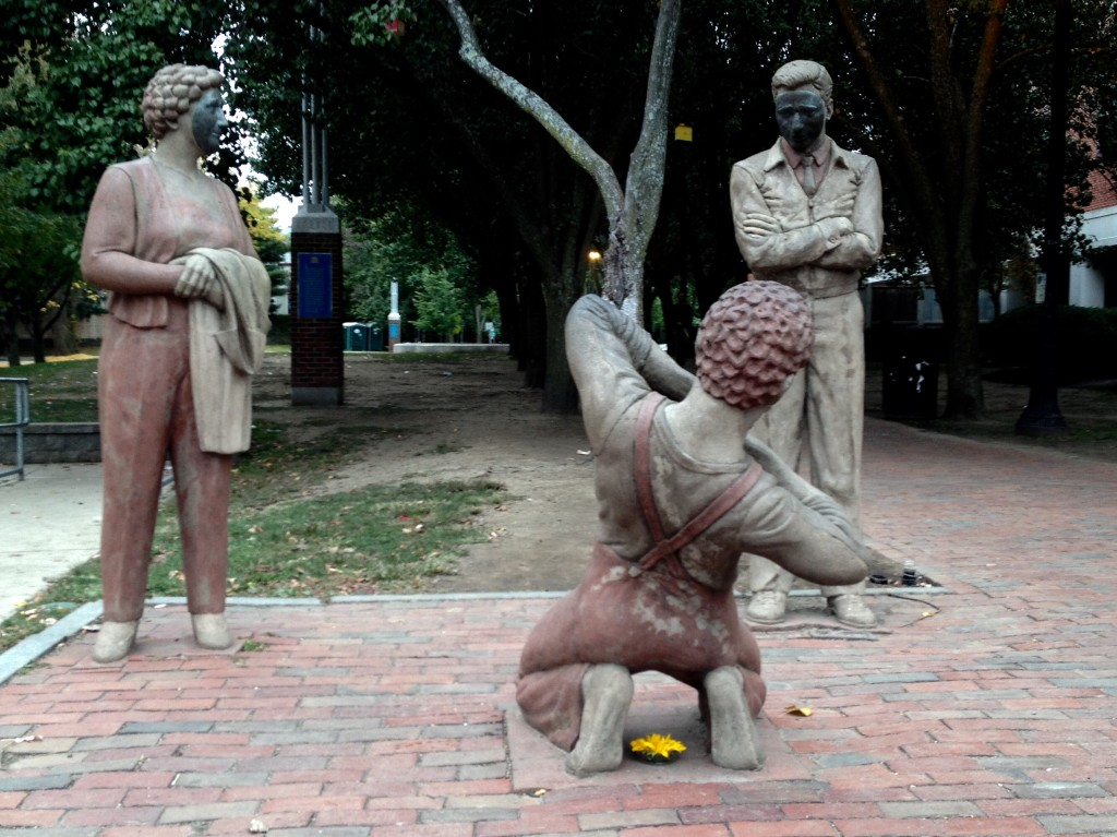 """Artist James Tyler created the human statues in Davis Square as a part of the """"Arts on the Line"""" project. (photo by Alison Graham)"""